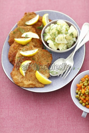 pork schnitzels with potatoes carrots and