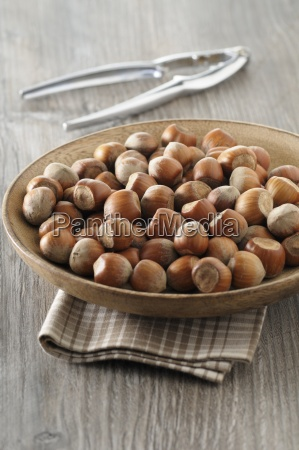 hazelnuts in a wooden bowl with