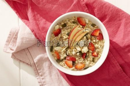 bircher mueesli with apple and strawberries
