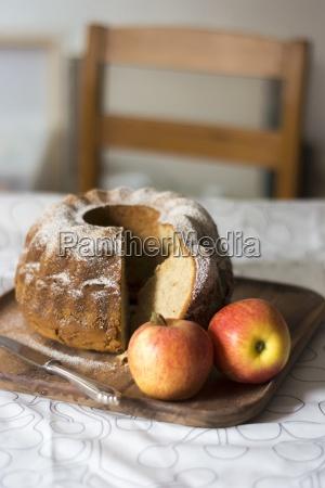 apple gugelhupf sliced on a wooden