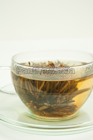 white tea with a blooming flower