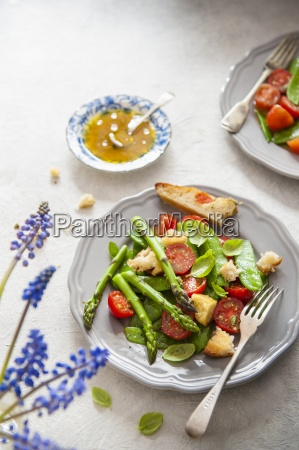 spring salad with green asparagus tomatoes