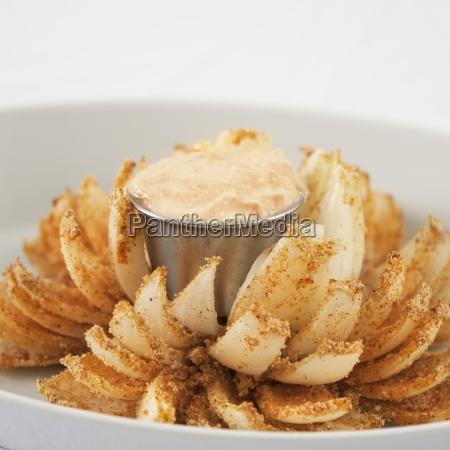 a baked onion arranged like a