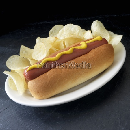 sausage in bun with mustard chips