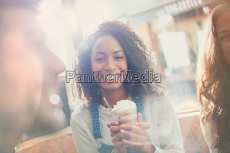 portrait smiling young woman drinking milkshake