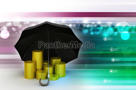 goldmuenzen unter einem schwarzen regenschirm