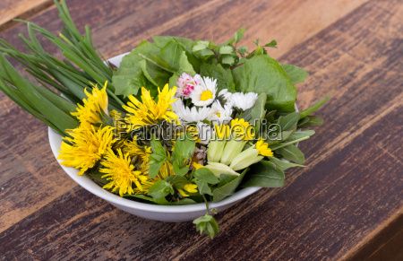 bowl with various fresh wild herbs