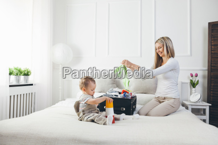 travelling with kids happy mother with