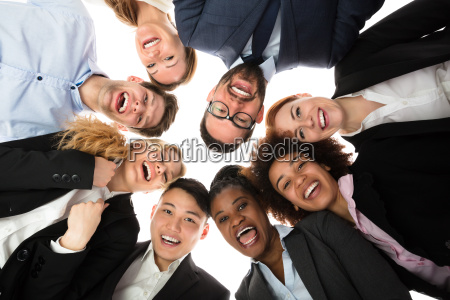 smiling businesspeople standing against white background
