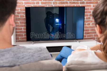 couple watching film at home