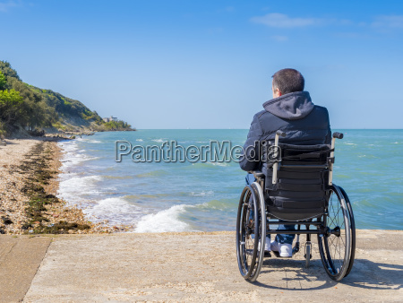 back of disabled man in wheelchair