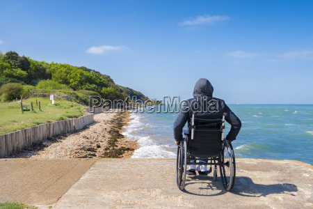 disabled young man sitting in a