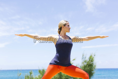 woman stretching on sunny day
