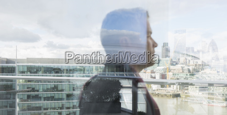 pensive businessman looking at urban city