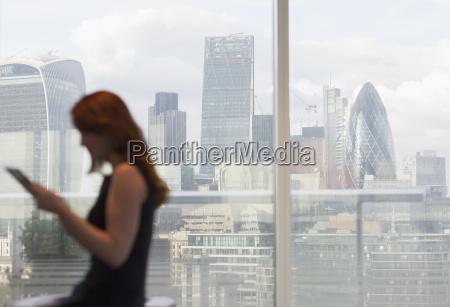 businesswoman using digital tablet at urban