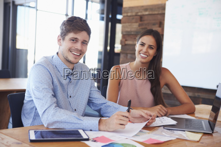 young male and female colleagues at