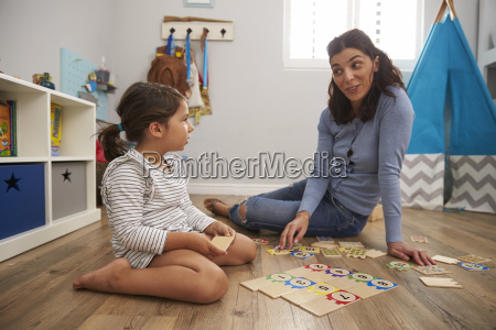 mother playing number puzzle game with