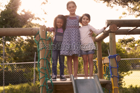 three girls playing outdoors at home