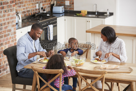 family eating meal in open plan