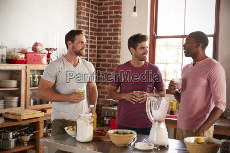 three male friends drinking homemade smoothies