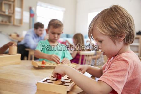 female pupil working at table in
