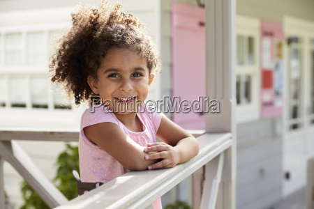 portrait of female pupil outside classroom