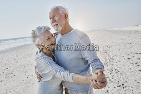 happy senior couple dancing on the