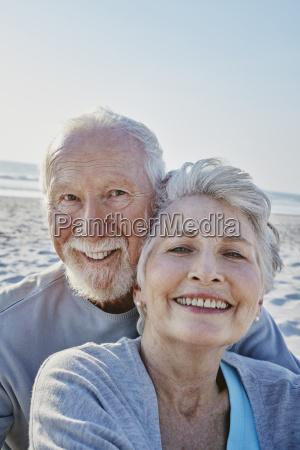 portrait of smiling senior couple on