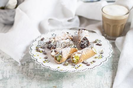 sicilian cannoli filled with ricotta cream