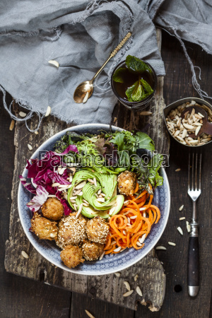 rainbow salad bowl with carrots lettuce