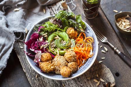 rainbow salad bowl with carrots lettuce