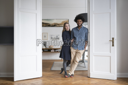 smiling couple at home standing in