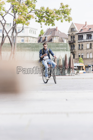 young man with bicycle in the