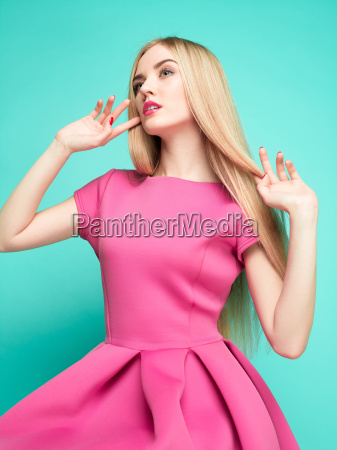 the beautiful young woman in pink