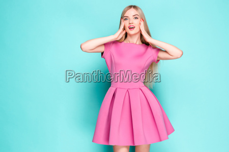 smiling beautiful young woman in pink
