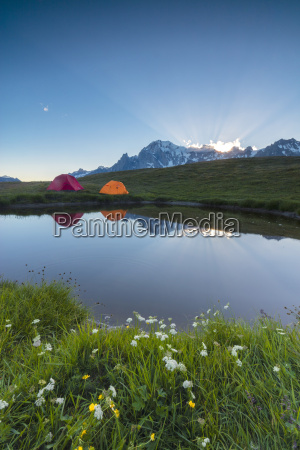 camping tents in the green meadows