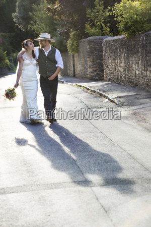 bride and groom walking along a