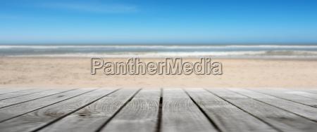 wooden terrace on an empty beach