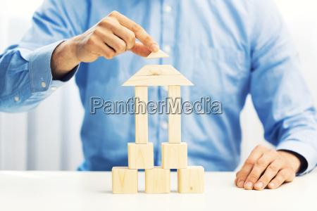 concept of businessman build his business
