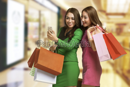 two young asian woman with shopping