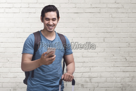young asian man journey with mobile