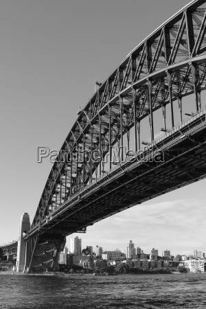 the sydney harbour bridge in grayscale