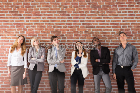 group of businesspeople looking up
