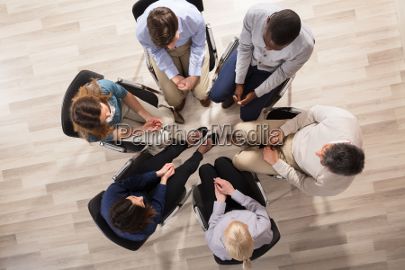 group of people sitting on chair
