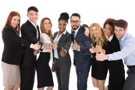 group of multiracial businesspeople gesturing thumbs