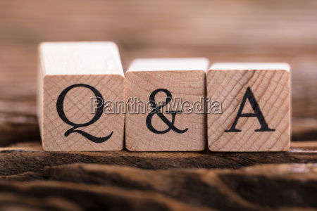 qa text on wooden block