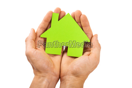 hands holding green house isolated on