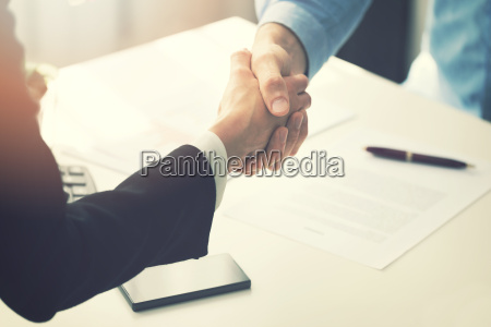 business people handshake after partnership contract