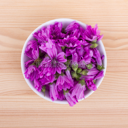 bowl with pink common mallow flowers