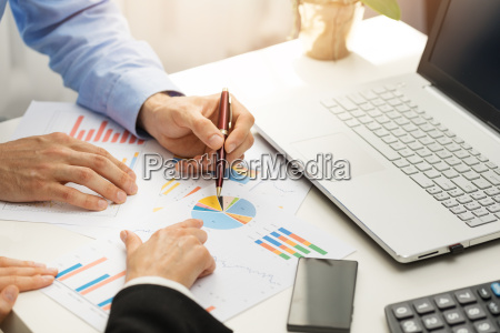 people at office analyzing business financial